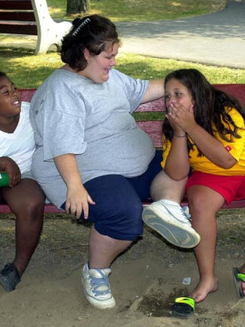Girls share a laugh before lunch at a New Image Weight Loss Camp at Camp Pocono Trails in Reeders...