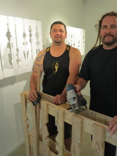 Gisborne artists Simon Lardelli (left) and Drew Hill present the raw material of pallets they use...
