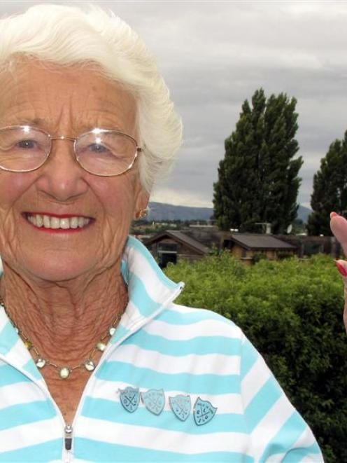 Glad Cross (91) with the 9-iron golf club she used to score her fifth hole in one, at the Wanaka...