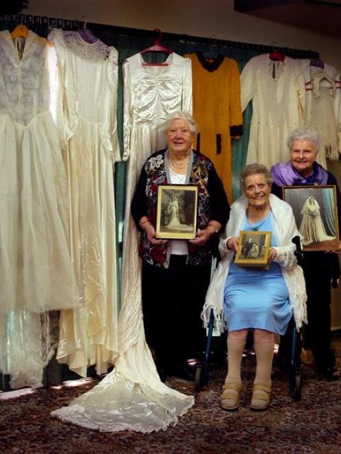 Gladys Morris (85), Nancy Edwards (97) and Noelene Wilson (82) pose with their wedding dresses...