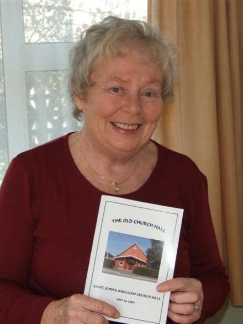 Glen Taylor, of Milton, at home with her book on the old St John's Anglican Church hall. Photo by...