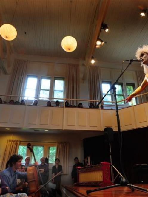 Gold-clad Dr Glam (Ian Chapman) performs David Bowie's Rebel, Rebel for University of Otago music...