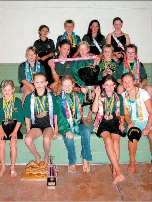 Good haul: The Alexandra Swimming Club with the spoils from the Otago championships — one of...