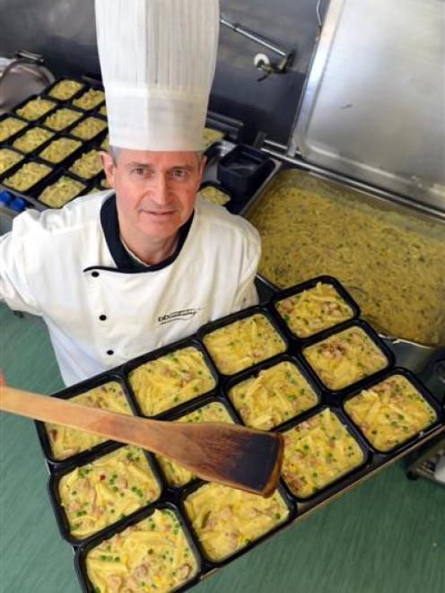 Gordon McKenzie prepares trays of chicken pasta bake ready to be frozen and dispatched to...