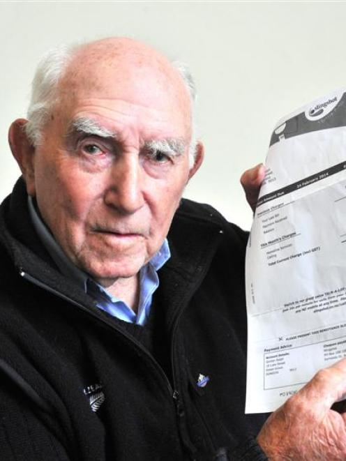 Gordon Ralph, of Ocean Grove, holds up a bill that someone allegedly opened before faking a reply...