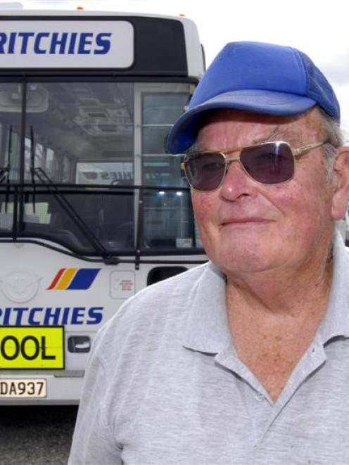 Gore bus driver Jim McCorkindale (70) beside his school bus in the Ritchies depot in Gore on...