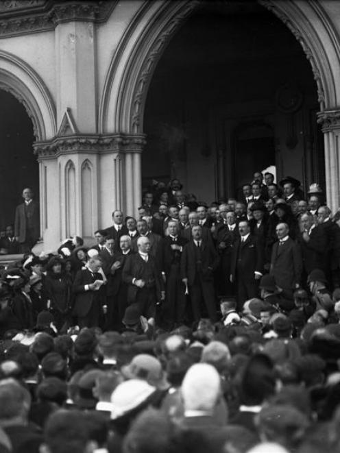 Governor Lord Liverpool (centre, holding telegram at his side) reads out Britain's declaration of...