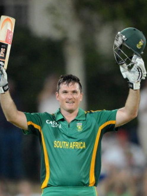 Graeme Smith of South Africa celebrates reaching 100 against New Zealand in the third one-day...