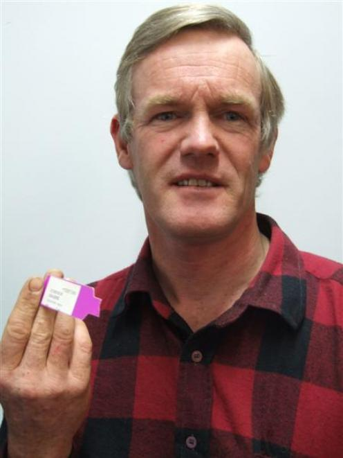 Oamaru man Graeme Simpson with the bracelet from his last hospital visit which he carries in his...