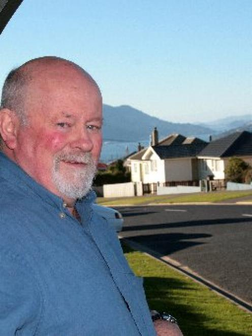 Graham McNeill waits for a bus in Corstorphine. He owns a former state house and has also built a...