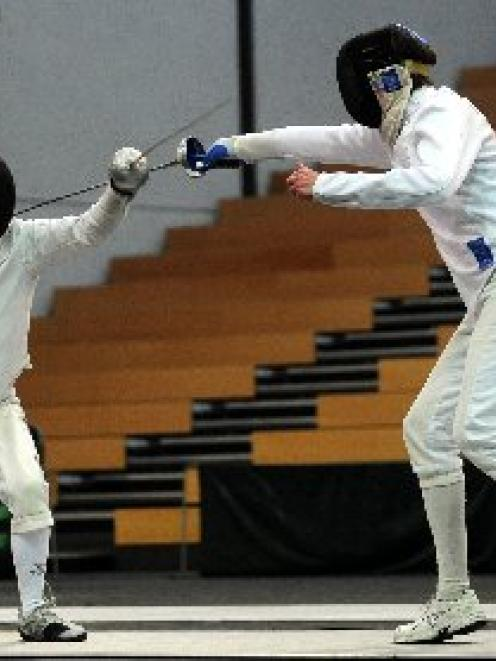 Graham Payne (left) and Brett Davis battle it out in the epee final of the New Zealand fencing...