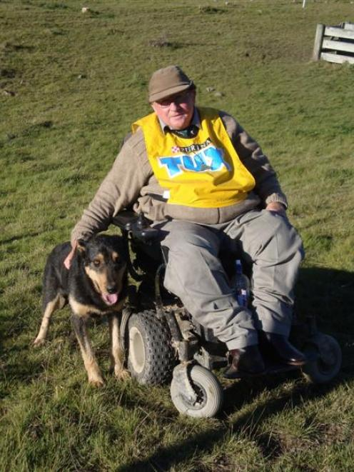 Grant Calder pats his dog Cramp after winning the South Island zigzag hunt championship at...