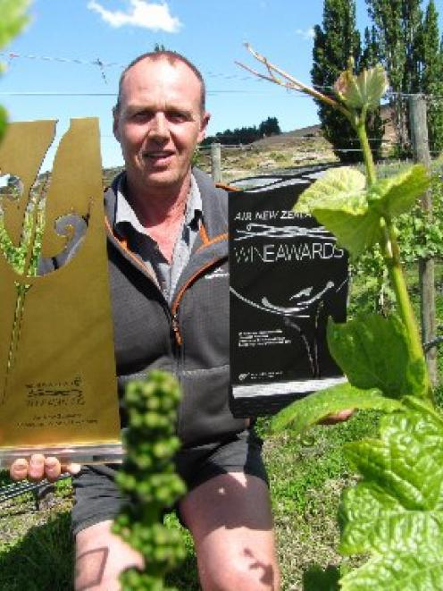 Grasshopper Rock vineyard manager and viticulturalist Mike Moffitt celebrates the vineyard's...