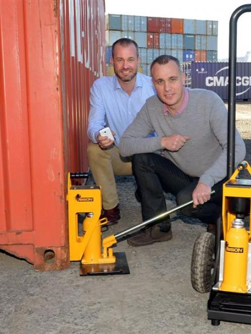 Greg (left) and Mark Fahey, from tech company Bison, with their container weighing system. Photo...