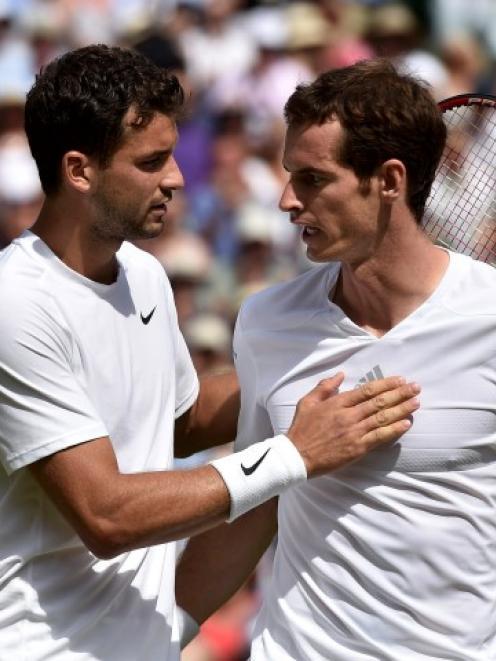 Grigor Dimitrov (L) speaks to Andy Murray after defeating him in their men's singles quarterfinal...
