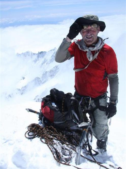Guide Geoff Wayatt enjoys his 24th visit to the top of Aoraki Mt Cook.  Photo by Philip Somerville.