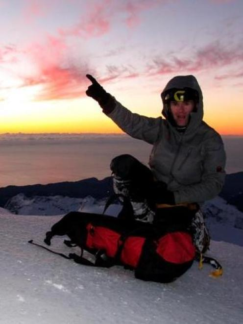 Guy McKinnon on top of Mt Tutoko. Photo supplied.