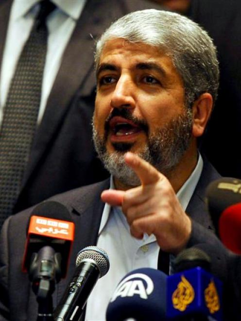 Hamas' leader in exile Khaled Meshaal speaks during a news conference about a cease-fire...