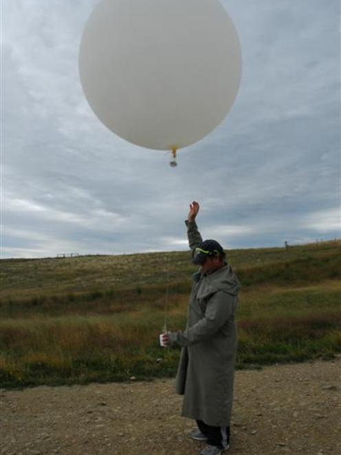 Hamish Chisholm launches a balloon at the Lauder Niwa station in Central Otago yesterday shortly...