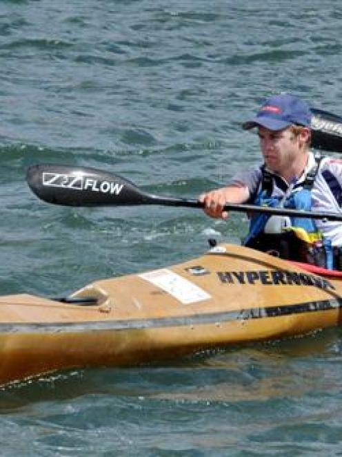 Hamish Fleming (left)  and Pete Smallfield begin the kayak stage of the adventure challenge on...