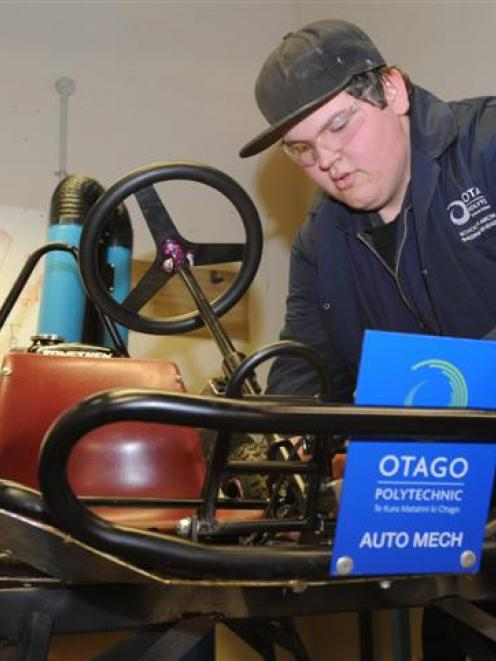 Hamish Mitchell-Wood (16), of Dunedin, makes final adjustments on Thursday to a grass racing kart...
