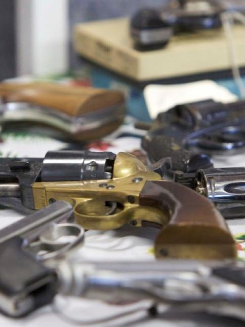 Handguns turned in are seen during a gun buyback event in Bridgeport, Connecticut, in the wake of...
