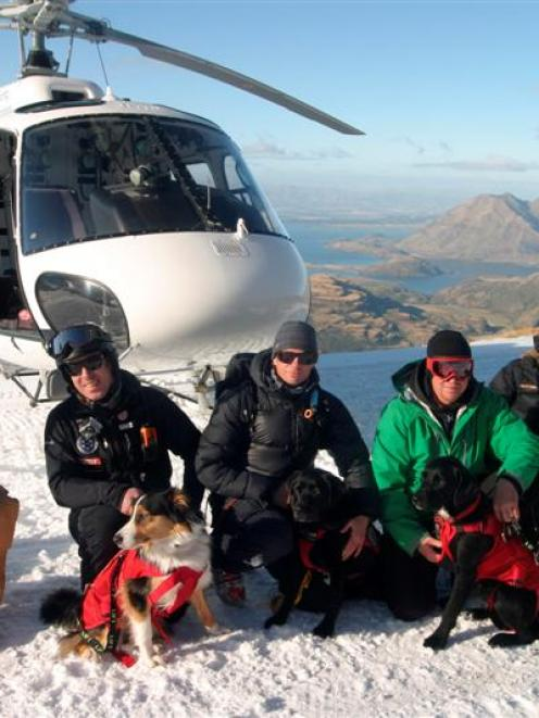 Handlers and dogs of the Wanaka Search and Rescue search-dog team at their first helicopter...