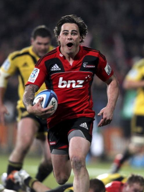 Happier times . . . Zac Guildford runs away to score a try for the Crusaders against the...