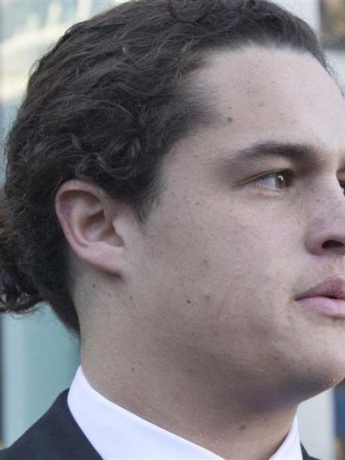 Hastings St John's College pupil Lucan Battison outside the High Court at Wellington last week....