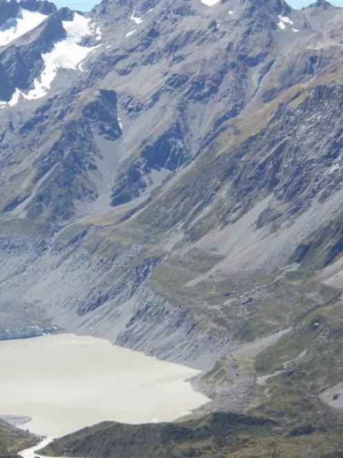 The glacial lake below the Hooker Glacier (centre left).  The glacier's retreat means the moraine...