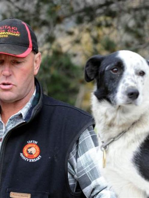 Head marshal Greg Metherell takes a call at the South Island sheep dog trial championships at...