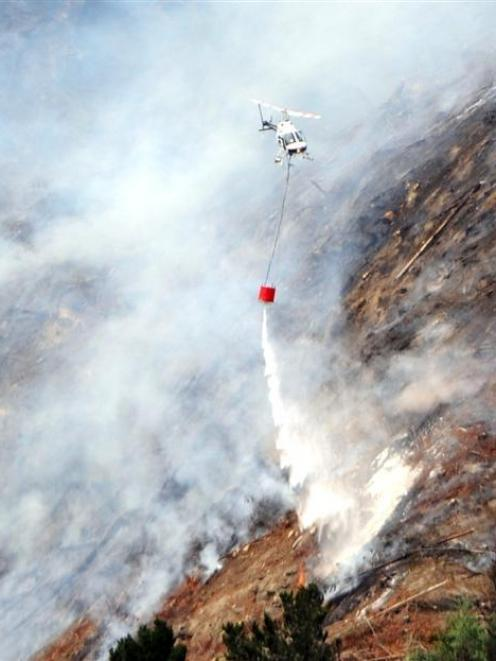 Helicopters fight a forest fire at Mt Allan last December. Photo by Peter McIntosh.