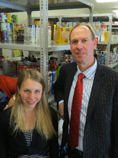 Helping hand ... Checking food-bank shelves ahead of the busy Christmas season are (from left)...