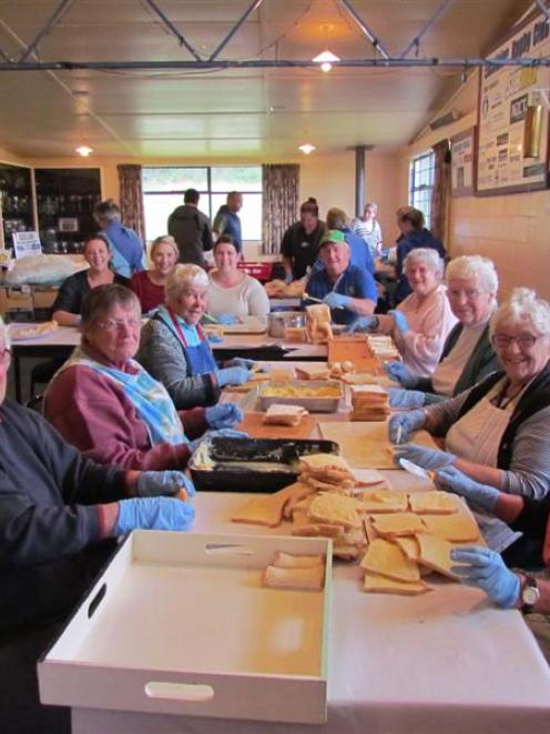 Helping make up 1500 dozen cheese rolls for the Excelsior Sports Clubs on Saturday were (front...