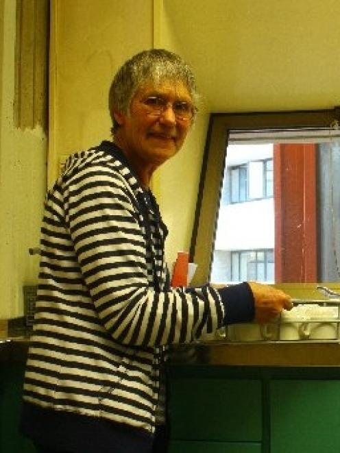 Helping out . . . Glenys Geytenbeek helps in the kitchen at the celebration of the International...