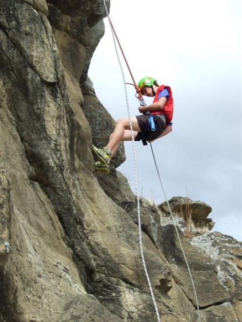 Henry Boyle (16), of Mt Aspiring College, makes good time in the abseiling section of the South...
