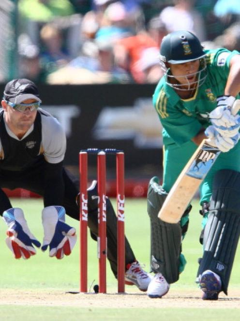 Henry Davids of South Africa and Brendon McCullum of New Zealand in action during the sides'...