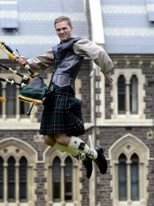 Highland piper Andrew McLean (20) celebrates his graduation from the University of Otago today....