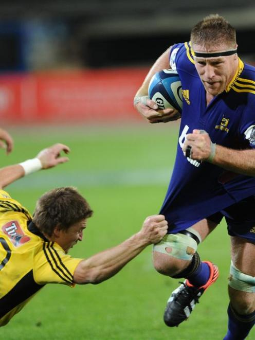 Highlander and ex-All Black Brad Thorn powers past the Hurricanes' Beauden Barrett during a Super...