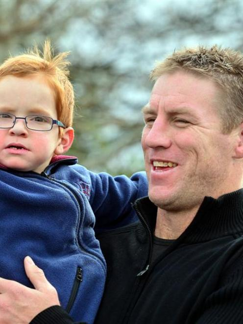 Highlander Brad Thorn and Sinclair May enjoy a special moment yesterday. Photo by Peter McIntosh.
