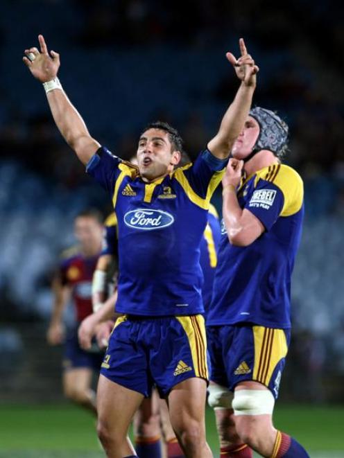 Highlander Daniel Bowden celebrates the win against the Crusaders in the Super 14 rugby match at...