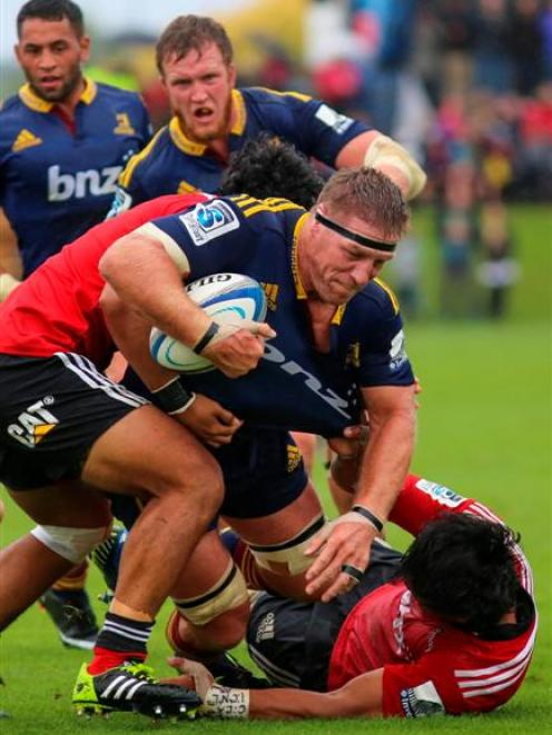Highlanders lock Brad Thorn takes the ball up during his side's pre-season match against the...