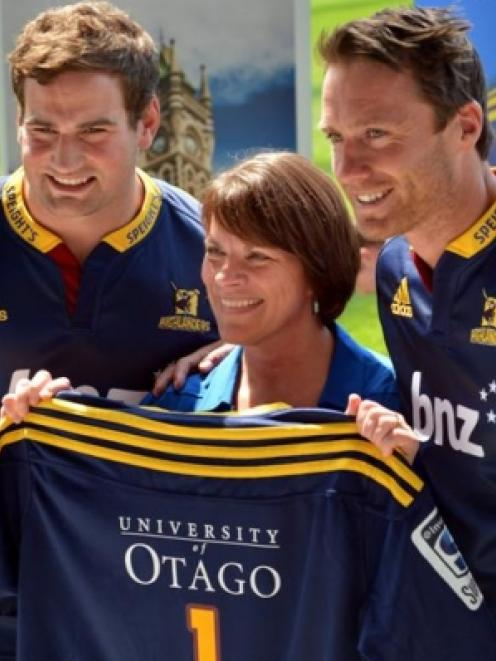 Highlanders player and University of Otago graduate Craig Millar (left) and co-captain and ...