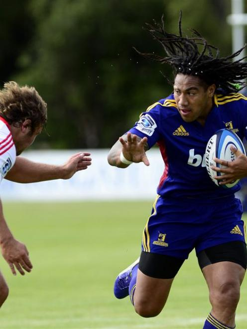 Highlanders second five-eighth Ma'a Nonu brushes off the tackle of Crusaders hooker Ben Funnell...