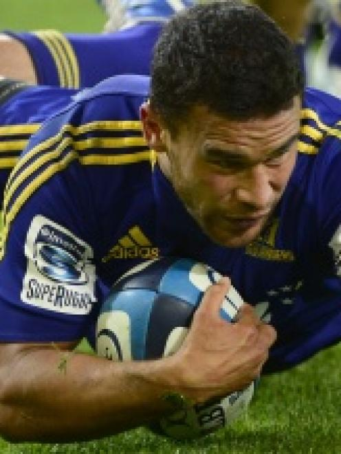 Highlanders winger Kade Poki scores against the Chiefs at the Forsyth Barr Stadium on Friday night.