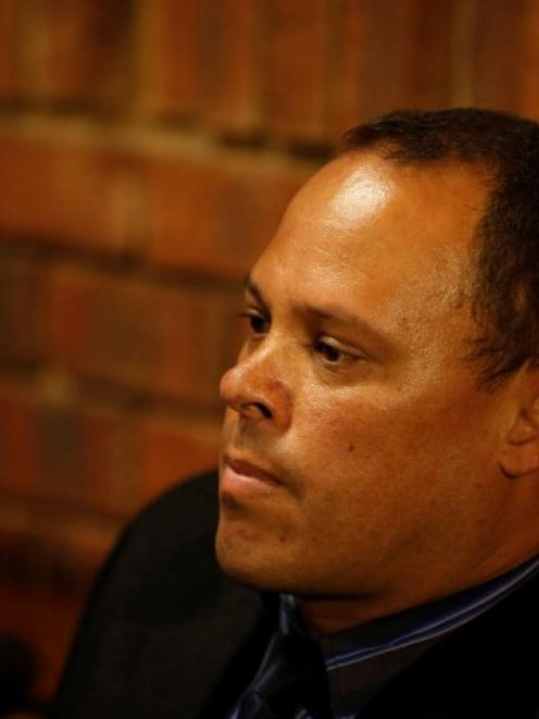 Hilton Botha relaxes during a break in court proceedings relating to the Pistorius home shooting,...