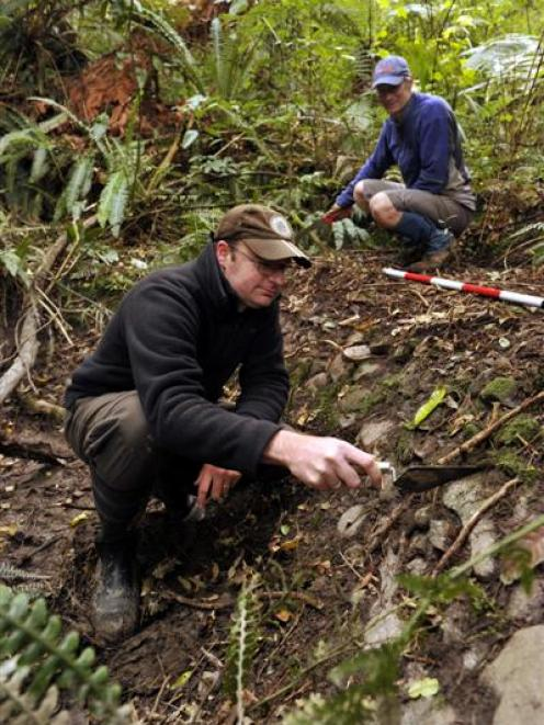 Historic Places Trust Otago-Southland regional archaeologist Matt Schmidt (front) and Mountain...