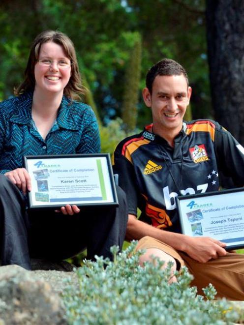Horticulture graduates Karen Scott and Joseph Tapuni. Photo by Gerard O'Brien.