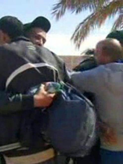 Hostages react after they were freed from a gas facility in Algeria where Islamist militants were...