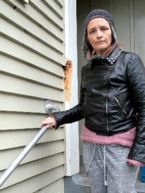 Housing New Zealand tenant Kerry Soroka inspects the condition of her Corstorphine home. Photo by...